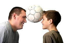 male-foster-carer-and-son-playing-football